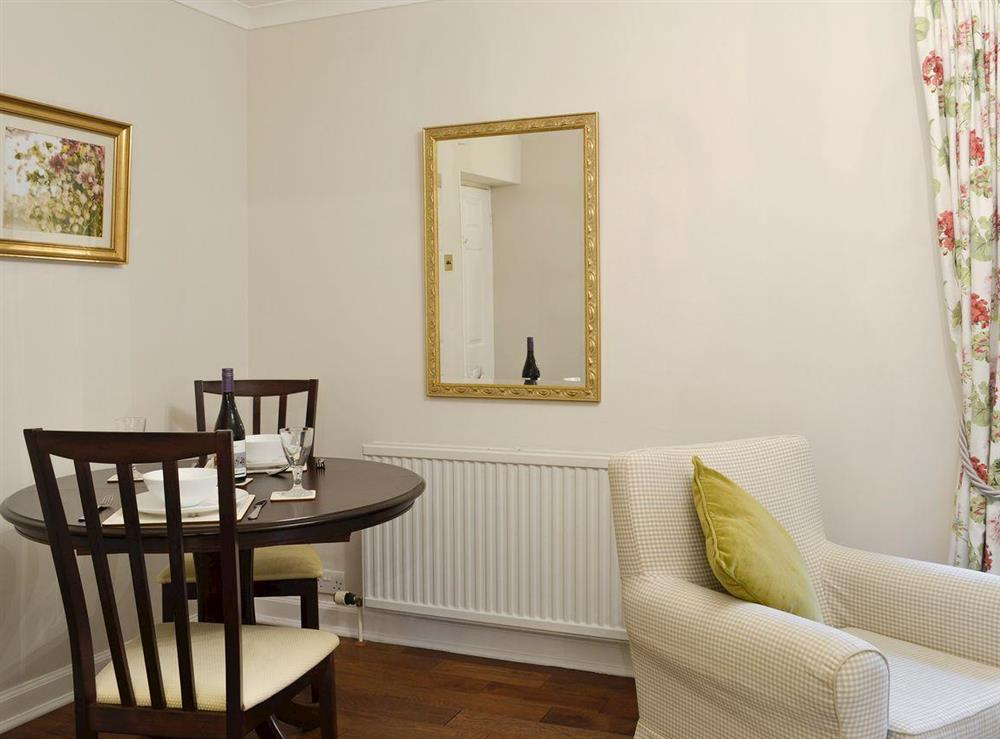 Convenient dining area within living room at Lilac Bank Cottage in Crosshill, near Maybole, Ayrshire