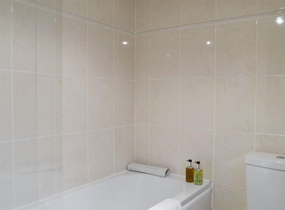 Family bathroom with shower over bath at Lilac Bank Cottage in Crosshill, near Maybole, Ayrshire