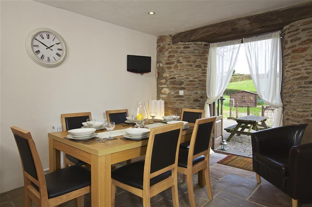 Dining area with doors out to the garden at Little Cotton Barn in Venn Lane, Nr Dartmouth