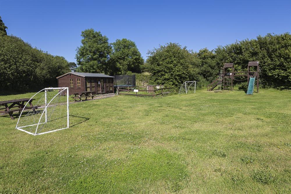 Children's outdoor play area at Little Cotton Farmhouse in Venn Lane, Nr Dartmouth