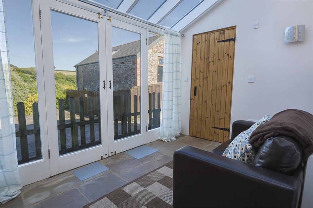 Sun room with countryside views at Little Cotton Farmhouse in Venn Lane, Nr Dartmouth