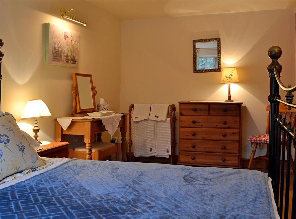 Double bedroom with charming dressing area at Leonards Cottage,
