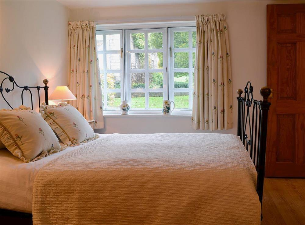 Antique style double bed at Upton Cottage,