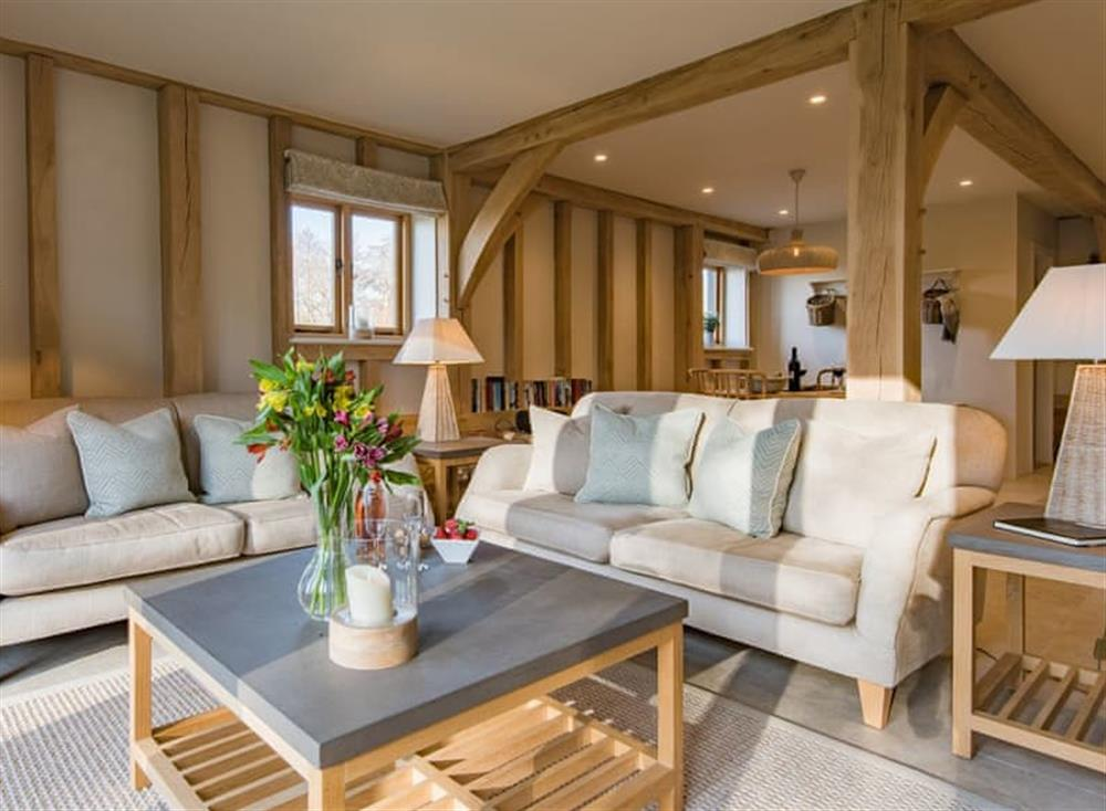 Open plan living space at Little Foxmoor Barn in Leith Hill, England