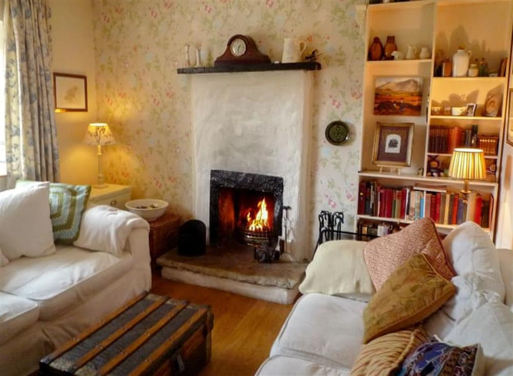 Living room with open fire at Little Irish Cottage in Crove, near Carrick, County Donegal, Ireland
