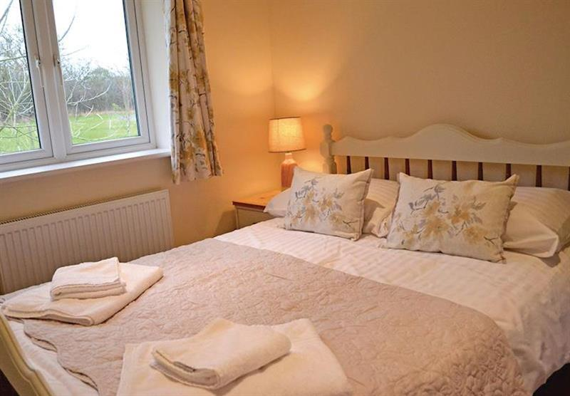 Double bedroom in a Hedgehog Lodge at Little Moorland Farm Lodges in Chapel Allerton, Somerset