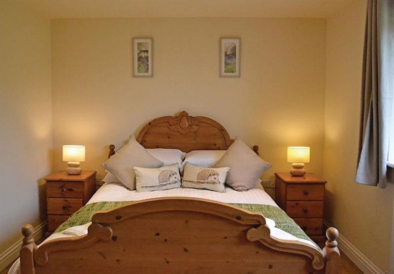 One of the double bedrooms in a Hedgehog Lodge at Little Moorland Farm Lodges in Chapel Allerton, Somerset