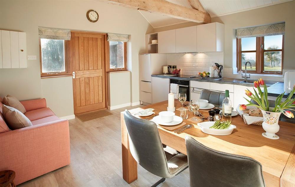 Bright Kitchen/Diner with Exposed Beams at Little Owls Barn, Preston Wynne