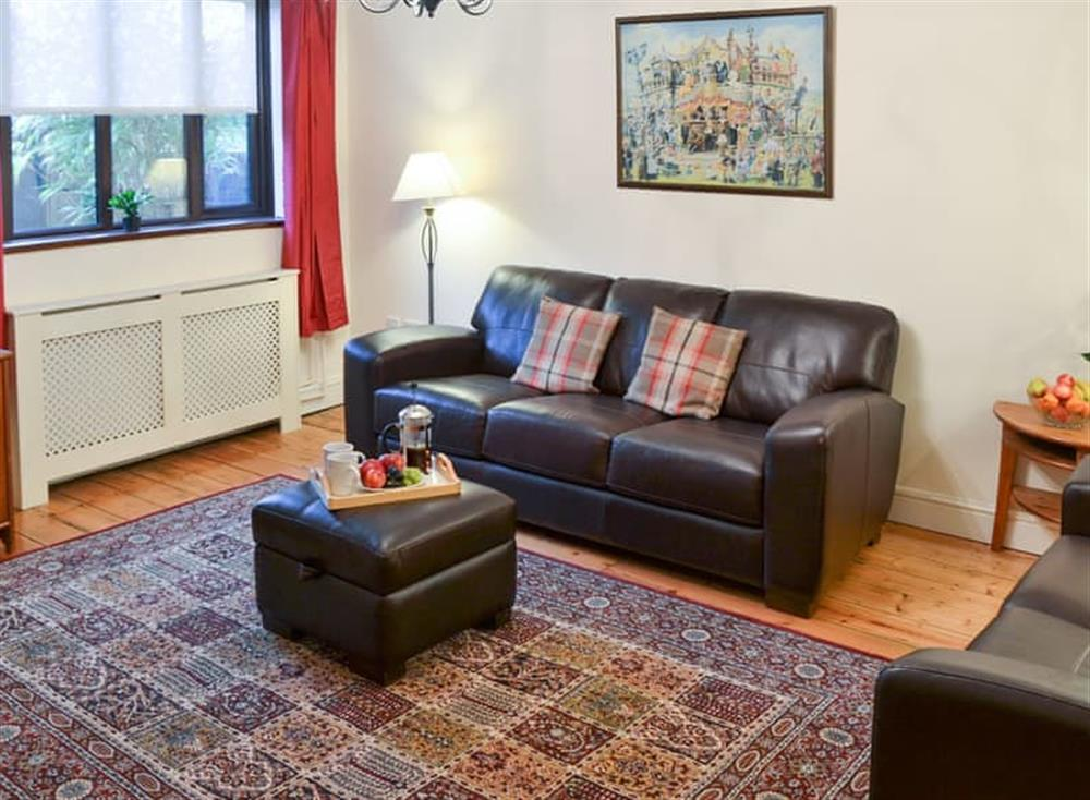 Warm and cosy living room at Lobelia Cottage in Stoke Holy Cross, near Norwich, Norfolk