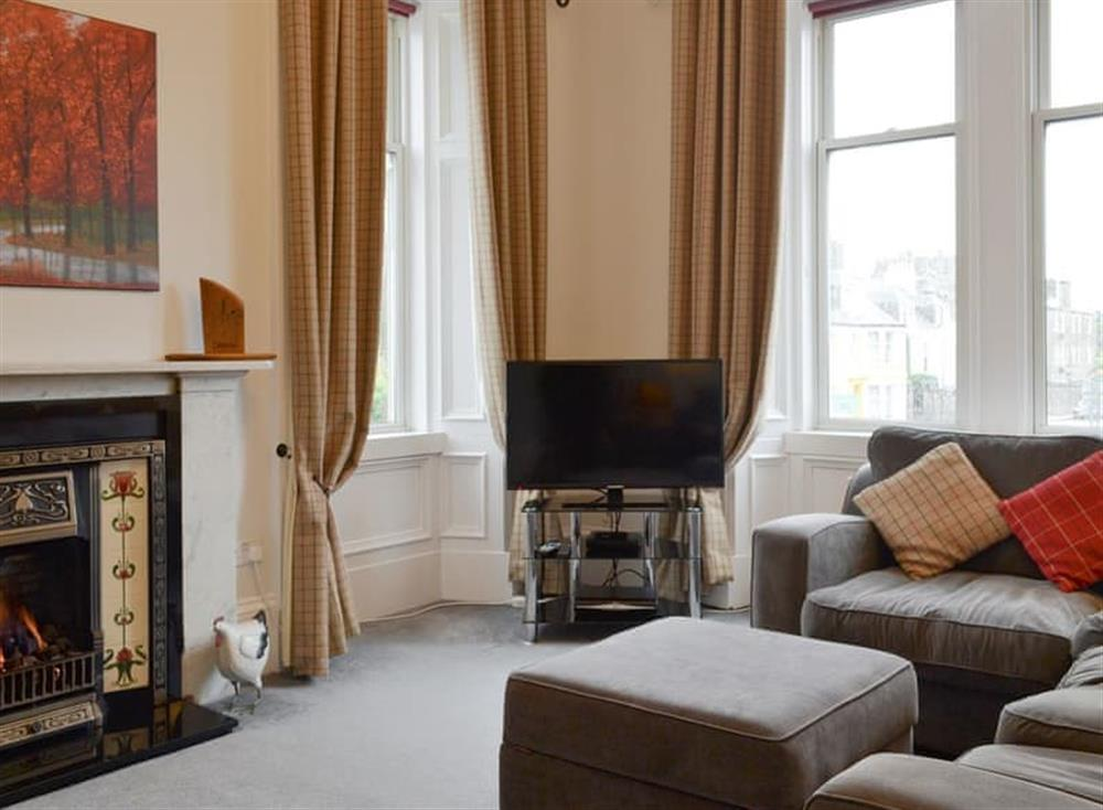 Welcoming living room with open fire at Loch View in Campbeltown, East Lothian