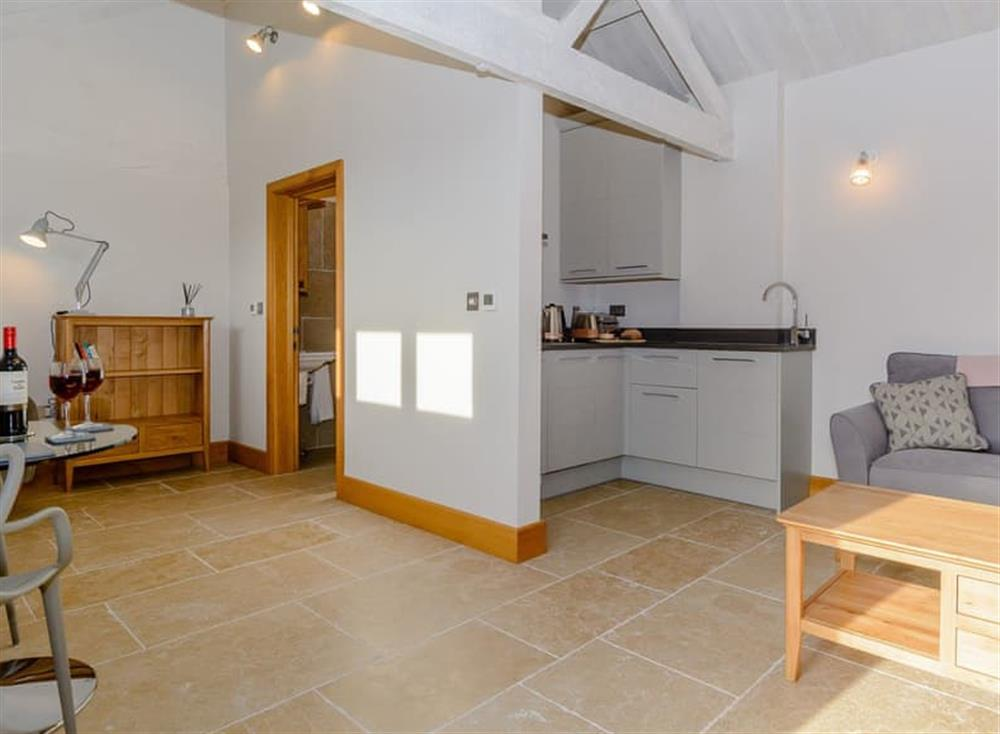 Spacious open plan living space with tiled floor (photo 3) at The Bull Pen 2,