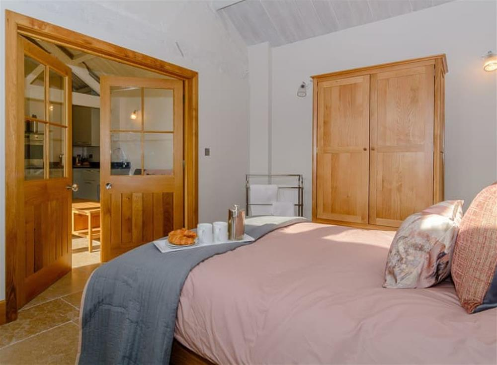 Tranquil bedroom with kingsize bed and beams (photo 2) at The Bull Pen 2,