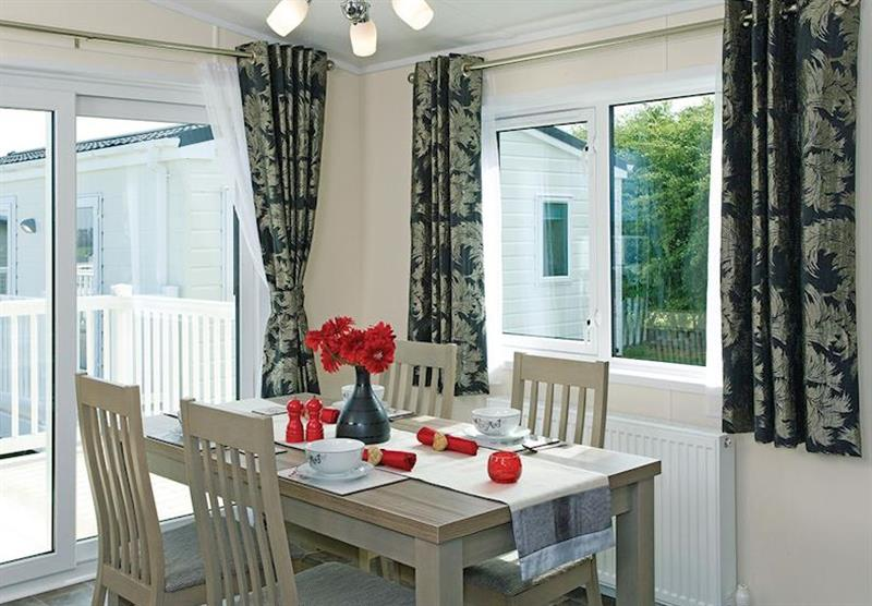 Dining area in the Kingfisher Lodge at Longmead Country Escapes in Cheddar, Nr Wells
