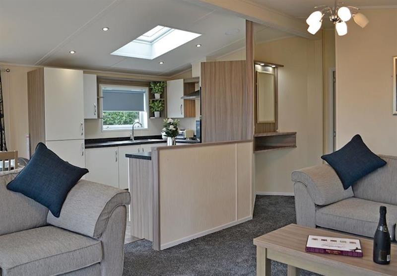 Living room and kitchen in the Kingfisher Lodge at Longmead Country Escapes in Cheddar, Nr Wells