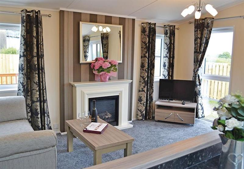 Living room in the Kingfisher Lodge at Longmead Country Escapes in Cheddar, Nr Wells