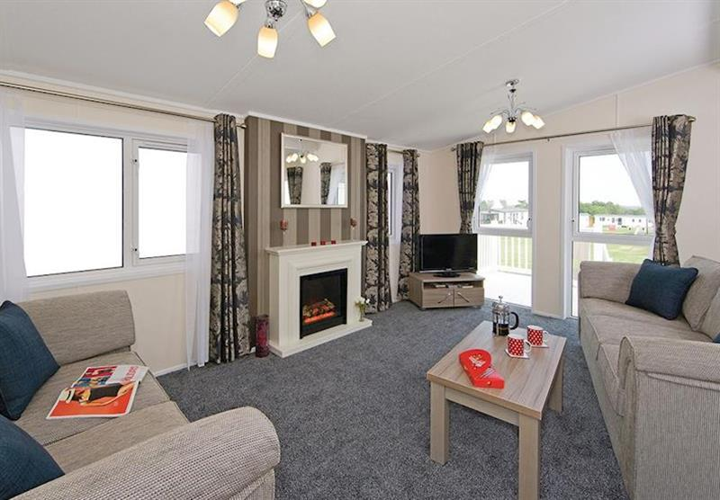 Living room in the Woodpecker Lodge at Longmead Country Escapes in Cheddar, Nr Wells