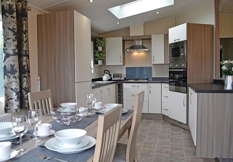 The kitchen and dining area in the Kingfisher Lodge at Longmead Country Escapes in Cheddar, Nr Wells