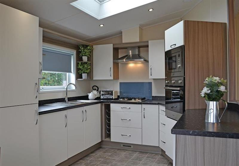 The kitchen in the Woodpecker Lodge at Longmead Country Escapes in Cheddar, Nr Wells