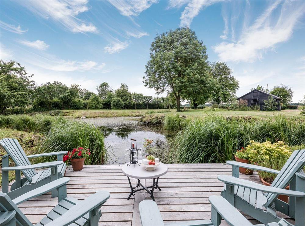 Relax beside the pond at The Summer House,