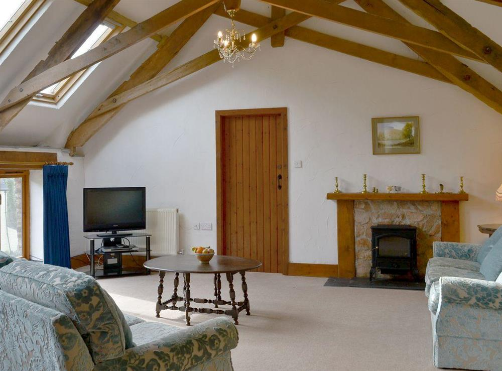 Living room  living room with spectacular vaulted ceilings and the original scissor beams at The Byre,