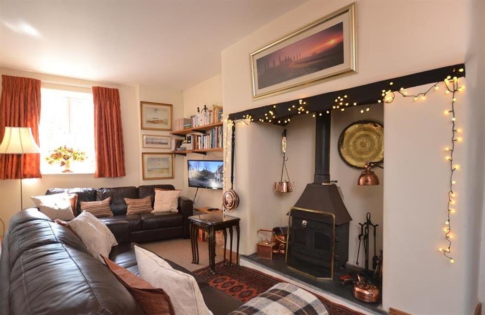 The living room with log burner at Lydiard Cottage, Loddiswell