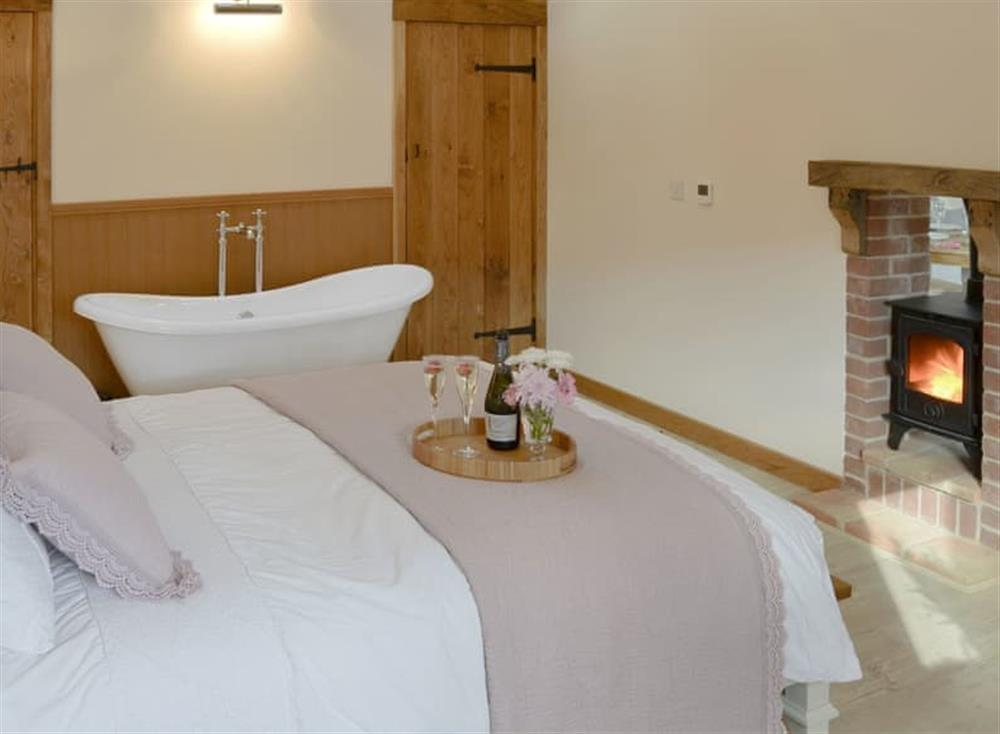 Romantic bedroom with free standing bath at Rabbits Rest,