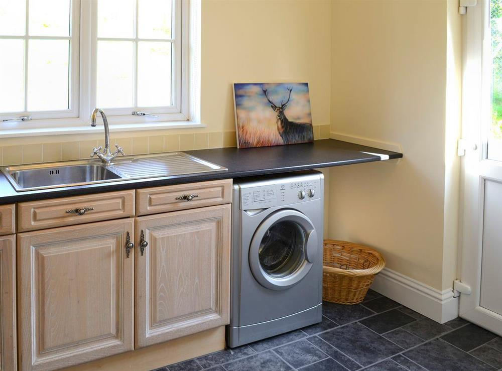 Convenient utility room at Maikle Cottage in Bonar Bridge, near Tain, Highlands, Ross-Shire