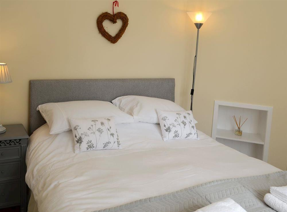 Cosy bedroom with double bed at Maikle Cottage in Bonar Bridge, near Tain, Highlands, Ross-Shire