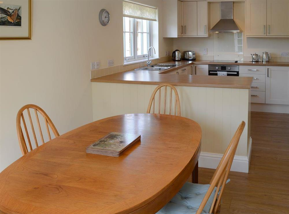Inviting kitchen and dining area at Maikle Cottage in Bonar Bridge, near Tain, Highlands, Ross-Shire