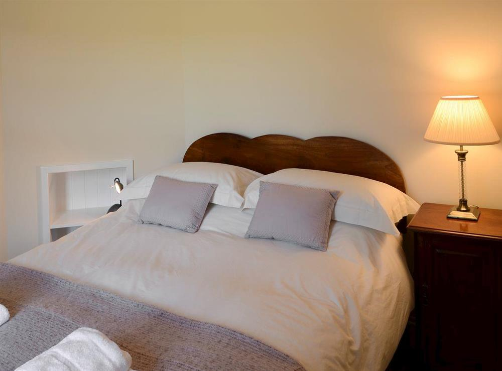 Relaxing bedroom with zip and link king-size bed at Maikle Cottage in Bonar Bridge, near Tain, Highlands, Ross-Shire
