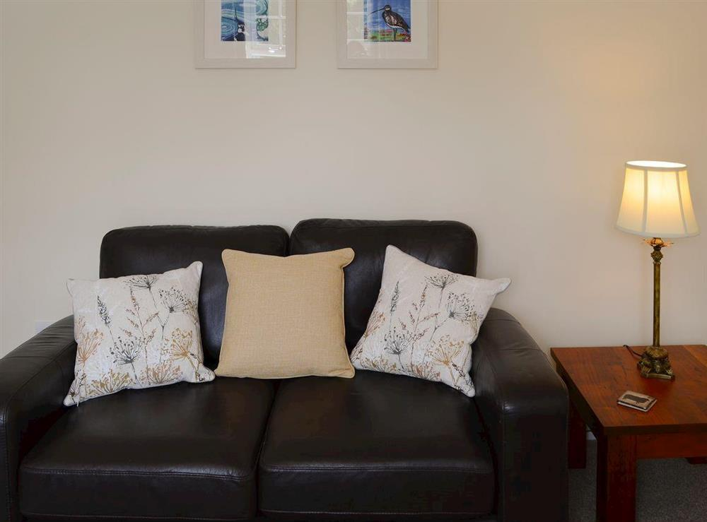 "Relaxing lounge with wood burner and 32"" Freeview TV at Maikle Cottage in Bonar Bridge, near Tain, Highlands, Ross-Shire"
