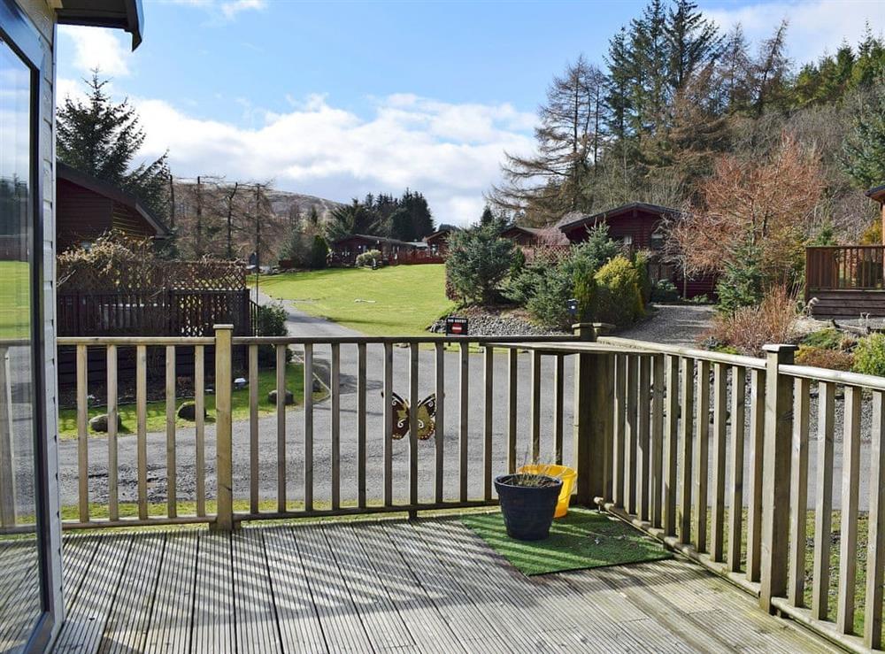 Relaxing decking area with stunning views at Malibu Lodge in Glen Devon, near Auchterarder, Clackmannanshire