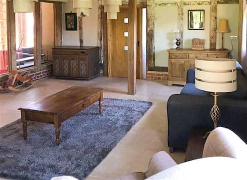 Living room at Manor Farm Barn in Pixey Green, near Eye, Suffolk