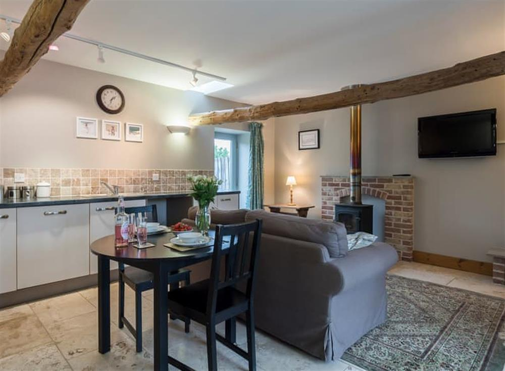 Open plan living space with marble floor at The Old Feedhouse,