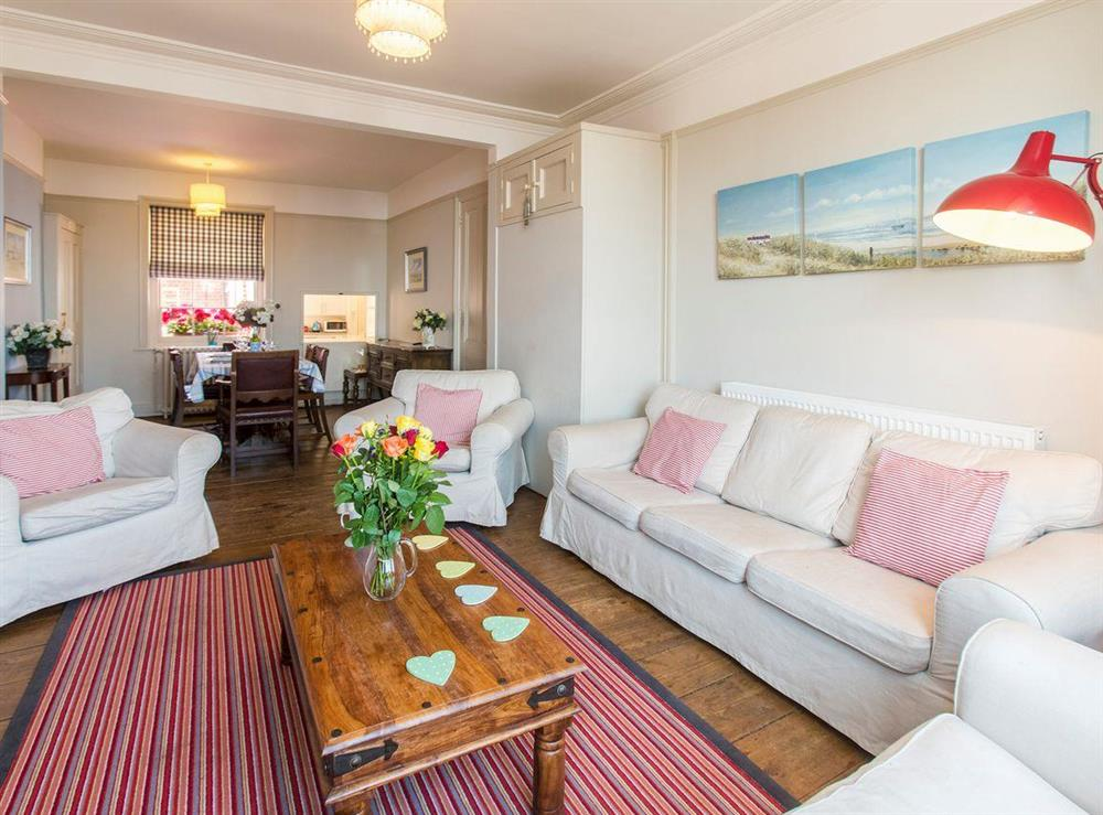 Comfy seating in living area of living and dining room at Market Cross Place in Aldeburgh, Suffolk