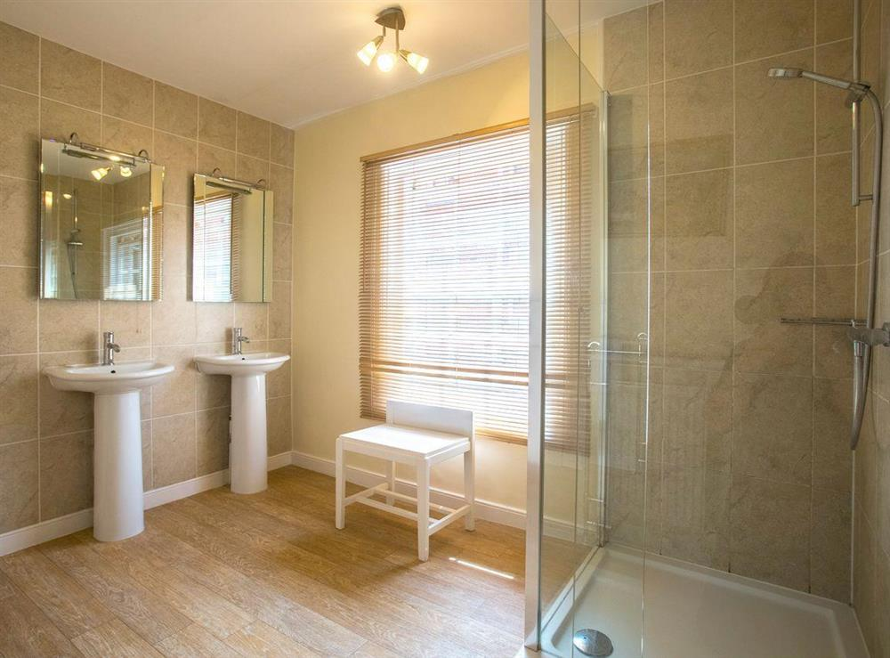 Large shower room with twin sinks at Market Cross Place in Aldeburgh, Suffolk