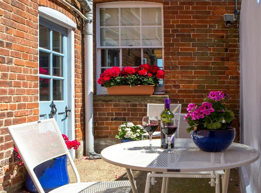 Rear courtyard with outdoor furniture at Market Cross Place in Aldeburgh, Suffolk