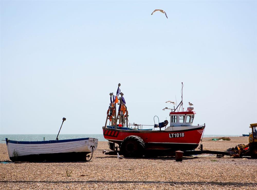 Traditional fishing boat on the nearby beach at Market Cross Place in Aldeburgh, Suffolk