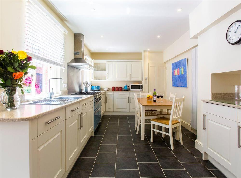 Well-equipped kitchen with informal dining area at Market Cross Place in Aldeburgh, Suffolk