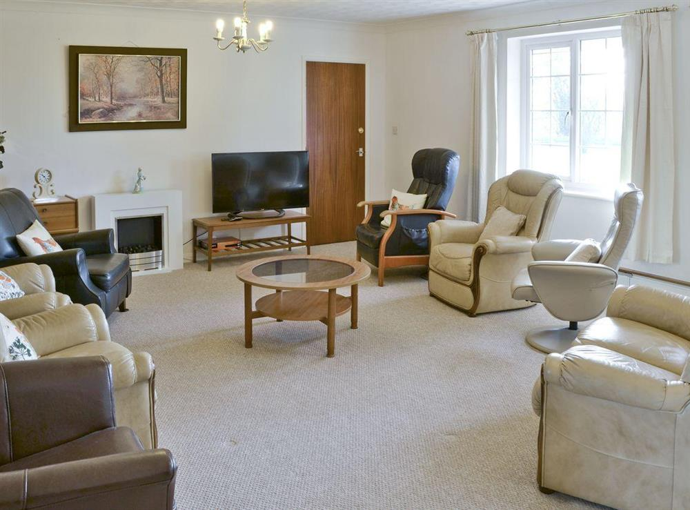 Bright comfy lounge at Marsh Farmhouse in Acle, Norwich, Norfolk