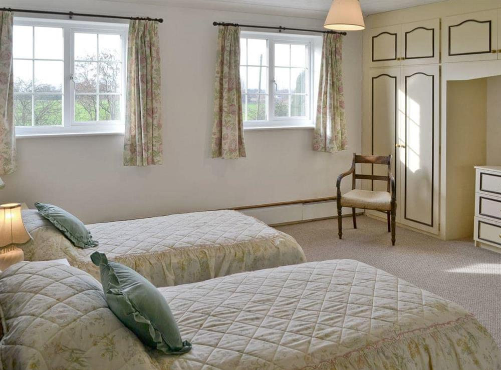 Great twin bedroom with built-in wardrobes and dressing table at Marsh Farmhouse in Acle, Norwich, Norfolk