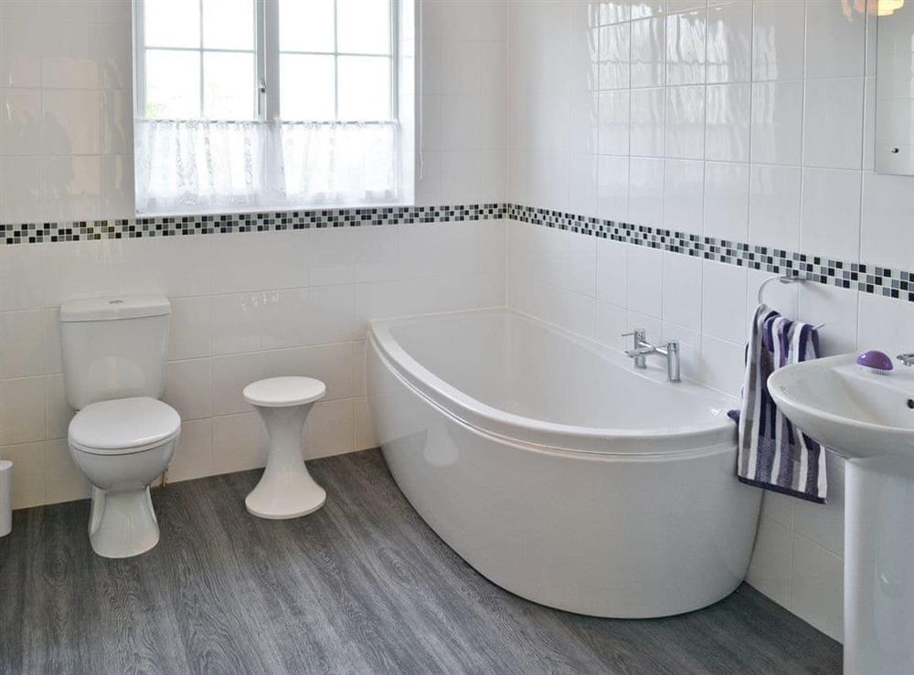 Stylish family bathroom at Marsh Farmhouse in Acle, Norwich, Norfolk