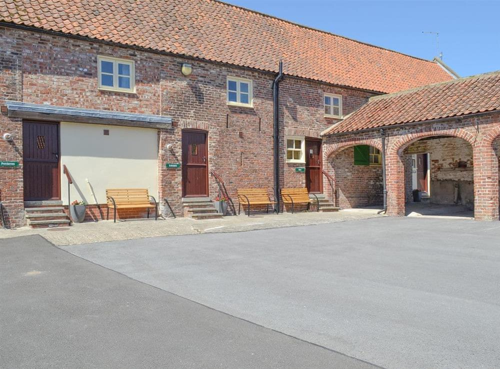 Large shared courtyard at Belgian Cottage,