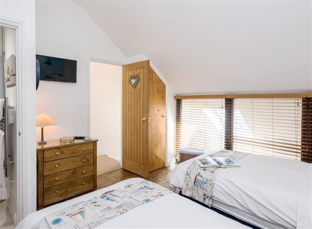 Comfortable twin bedroom with zip & link beds which can be made into a super kingsize on request at The Boat Shed,