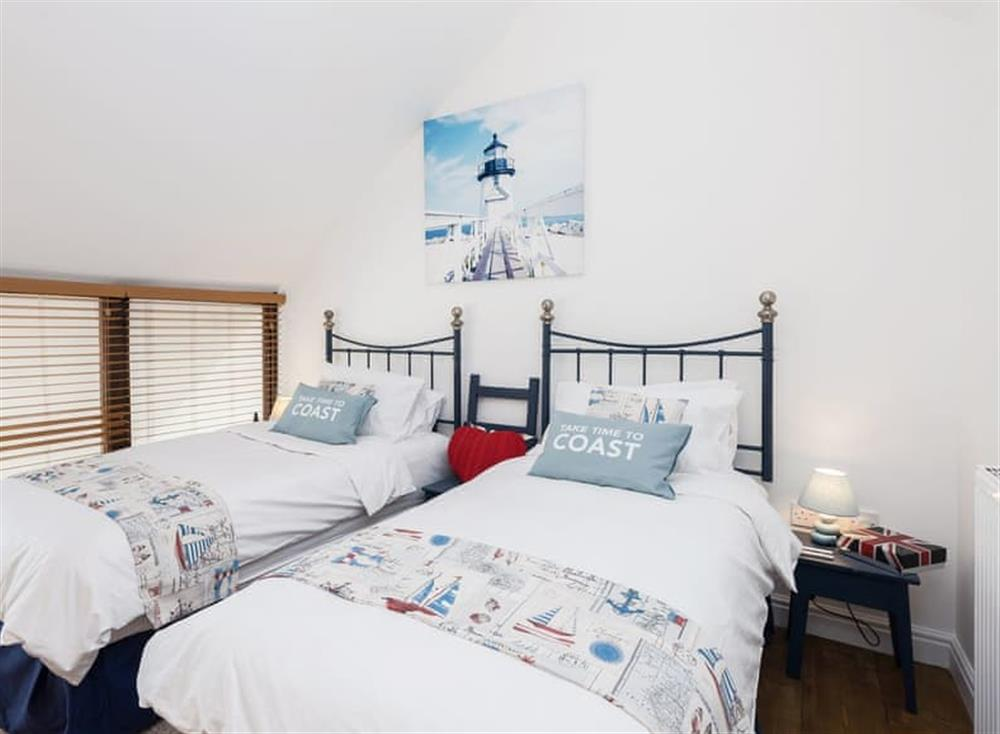 Cosy bedroom with zip and link twin beds which can be made into a super kingsize on request at The Boat Shed,