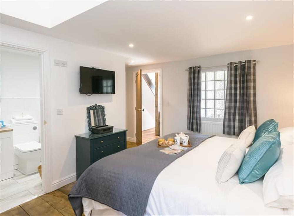 Spacious double bedroom with super kingsize bed which can be a twin on request at The Boat Shed,