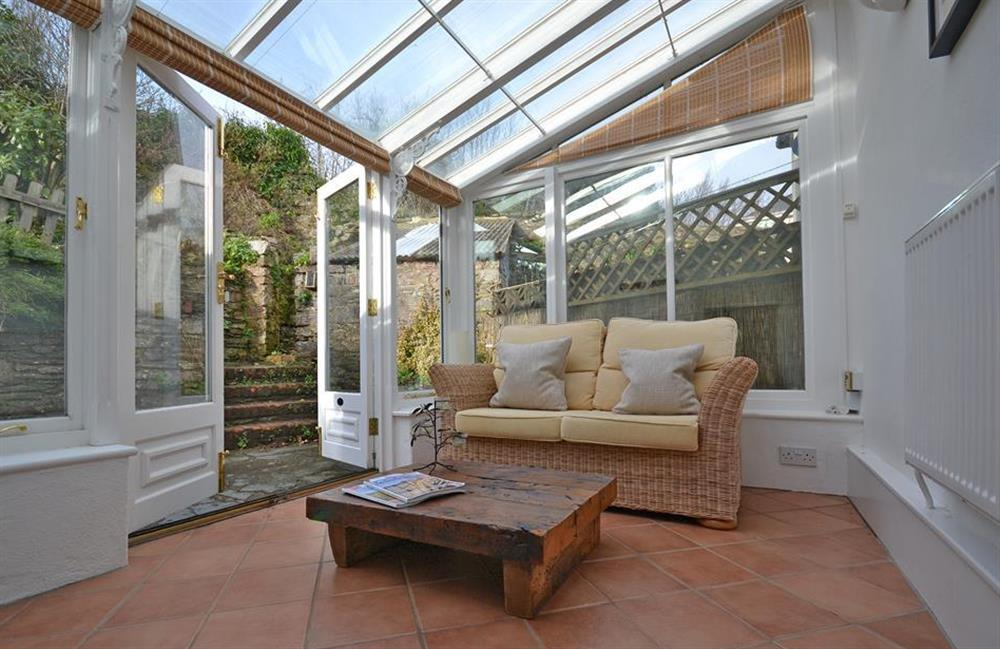 Additional living space within the conservatory at Meadow View Cottage, Dittisham