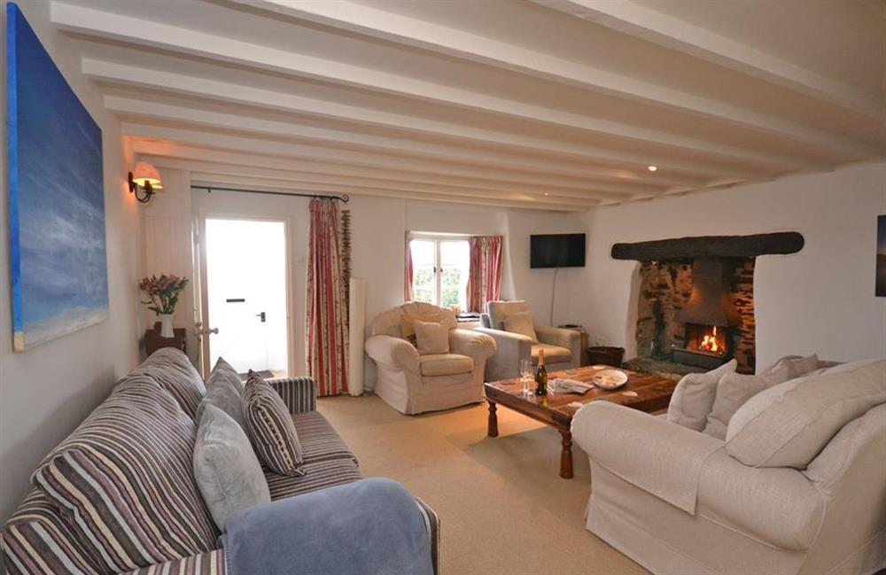 The beams and inglenook fireplace are lovely features at Meadow View Cottage, Dittisham