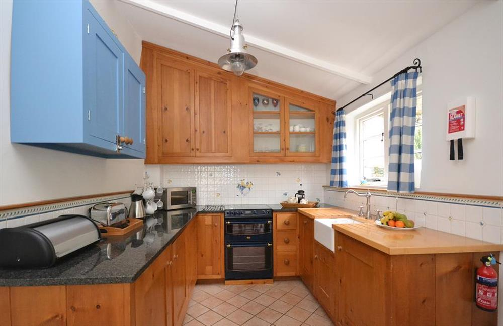 The bespoke wooden kitchen is very well equipped at Meadow View Cottage, Dittisham