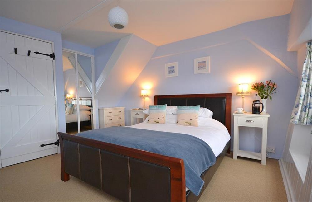 The large and light master bedroom at Meadow View Cottage, Dittisham